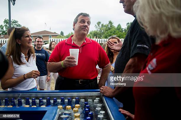 Chris Christie governor of New Jersey and 2016 Republican presidential candidate and his wife Mary Pat Christie listen to an attendee during the Iowa...