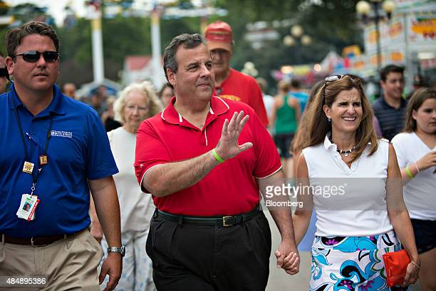 Chris Christie governor of New Jersey and 2016 Republican presidential candidate walks with his wife Mary Pat Christie right as they greet attendees...