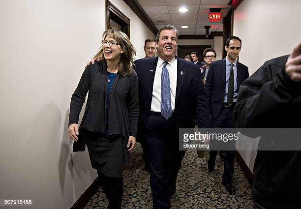 Chris Christie governor of New Jersey and 2016 Republican presidential candidate center exits after speaking at the Bull Moose Club luncheon in Des...