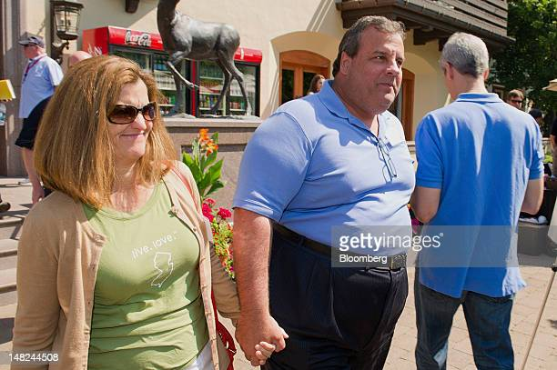 Chris Christie governor of New Jersey center and his wife Mary Pat Christie left leave the morning session during the Allen Co Media and Technology...