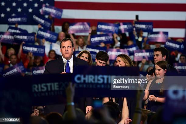 Chris Christie governor of New Jersey is joined by his family while speaking at Livingston High School in Livingston New Jersey US on Tuesday June 30...