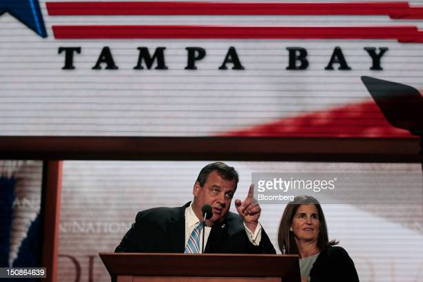 Chris Christie governor of New Jersey left and wife Mary Pat Foster prepare to speak during a walk through at the Republican National Convention in...