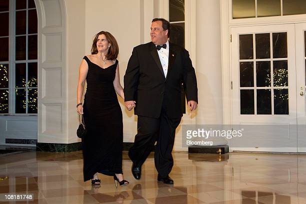 Chris Christie governor of New Jersey right and his wife Mary Pat arrive for a state dinner hosted by US President Barack Obama and first lady...