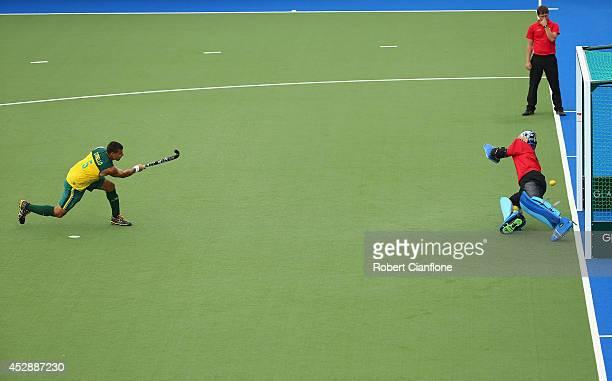 Chris Ciriello of Australia scores a penaty shot past Sreejesh Parattu Raveendran of India during the men's preliminaries match between India and...