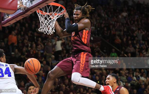 Chris Clarke of the Virginia Tech Hokies celebrates after dunking against the Duke Blue Devils in the second half at Cassell Coliseum on February 26...