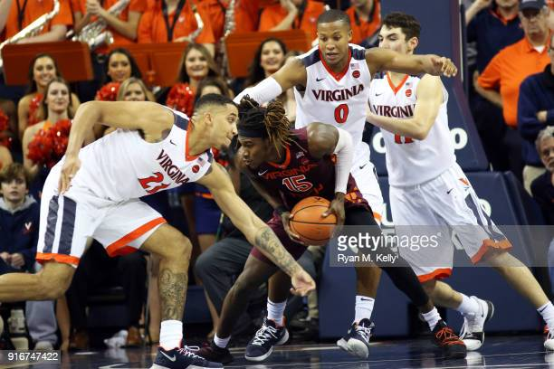 Chris Clarke of the Virginia Tech Hokies controls the ball between Isaiah Wilkins Devon Hall and Ty Jerome of the Virginia Cavaliers in overtime...