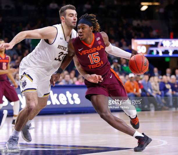 Chris Clarke of the Virginia Tech Hokies dribbles the ball against John Mooney of the Notre Dame Fighting Irish at Purcell Pavilion on January 27...