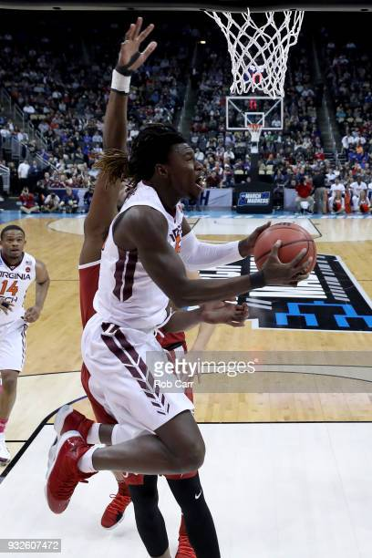 Chris Clarke of the Virginia Tech Hokies shoots the ball against Donta Hall of the Alabama Crimson Tide during the first half of the game in the...