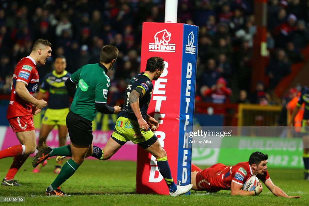 Chris Clarkson (R) of Hull KR dives in to score a try during the BetFred Super League match between Hull KR and Wakefield Trinity at KCOM Craven Park on February 2, 2018 in Hull, England
