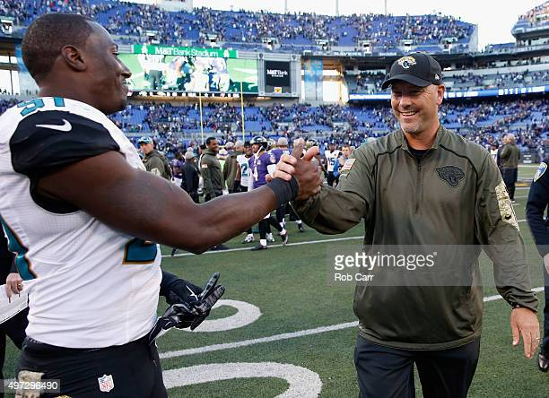 Chris Clemons and head coach Gus Bradley of the Jacksonville Jaguars walk off the field following the Jaguars 2220 win over the Baltimore Ravens at...