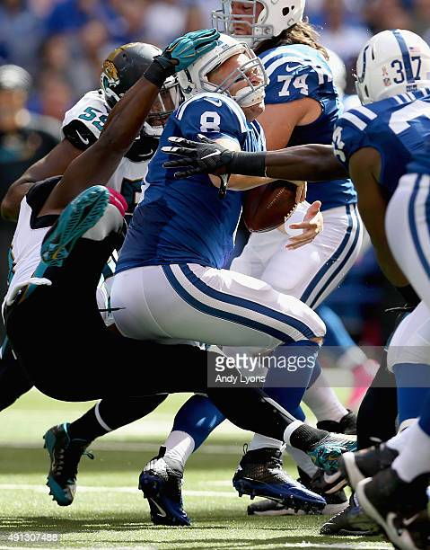 Chris Clemons of the Jacksonville Jaguars sacks Matt Hasselbeck of the Indianapolis Colts at Lucas Oil Stadium on October 4 2015 in Indianapolis...