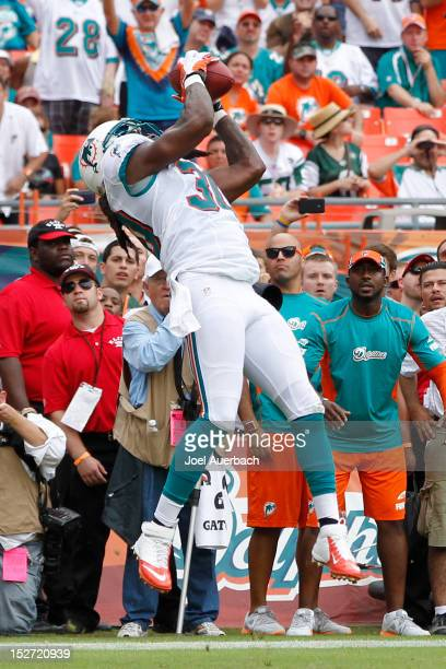 Chris Clemons of the Miami Dolphins intercepts a ball thrown by Mark Sanchez of the New York Jets in the end zone on September 23 2012 at Sun Life...