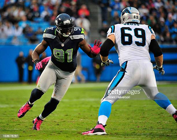 Chris Clemons of the Seattle Seahawks rushes against Jordan Gross of the Carolina Panthers at Bank of America Stadium on October 7 2012 in Charlotte...