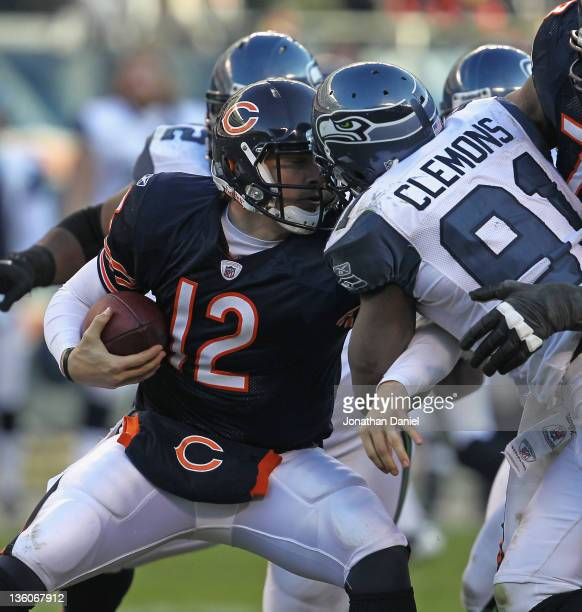 Chris Clemons of the Seattle Seahawks sacks Caleb Hanie of the Chicago Bears at Soldier Field on December18 2011 in Chicago Illinois The Seahawks...