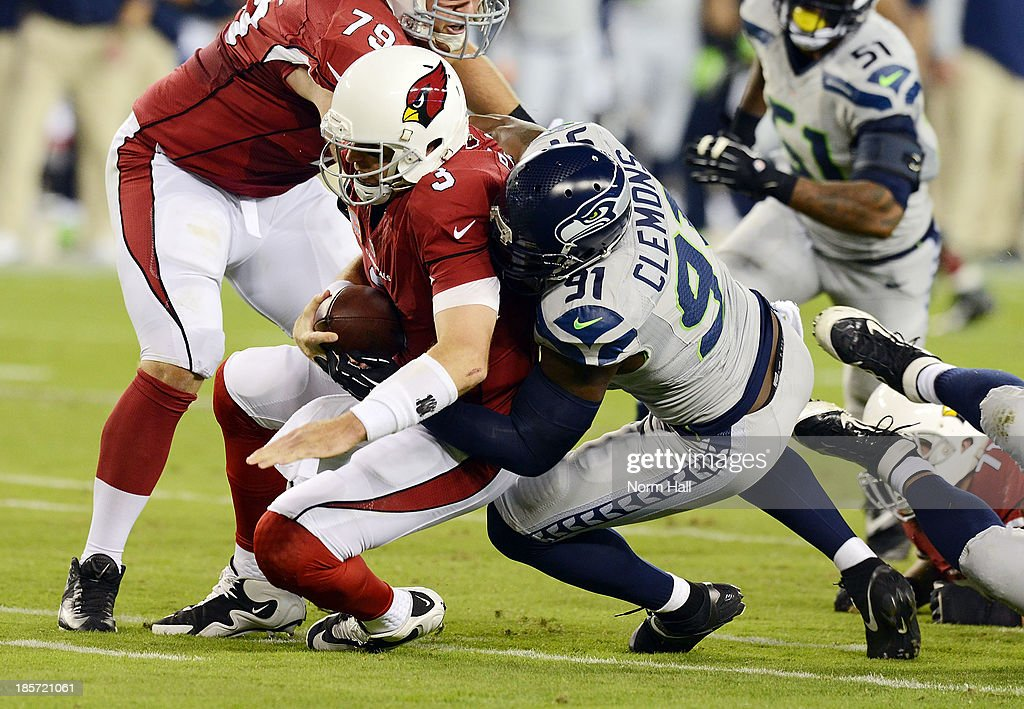 Chris Clemons #91 of the Seattle Seahawks sacks Carson Palmer #3 of the Arizona Cardinals at University of Phoenix Stadium on October 17, 2013 in Glendale, Arizona.