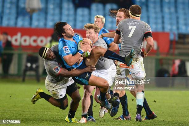 Chris Cloete of the Southern King tackles Jan Serfontein of the Bulls during the Super Rugby match between Vodacom Bulls and Southern Kings at Loftus...