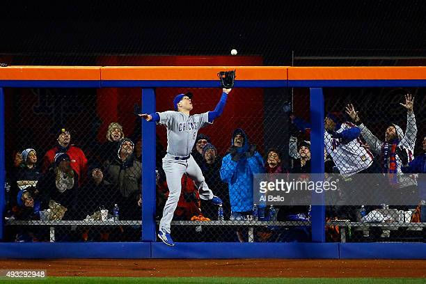 Chris Coghlan of the Chicago Cubs catches a pop up fly hit by Yoenis Cespedes of the New York Mets in the sixth inning during game two of the 2015...