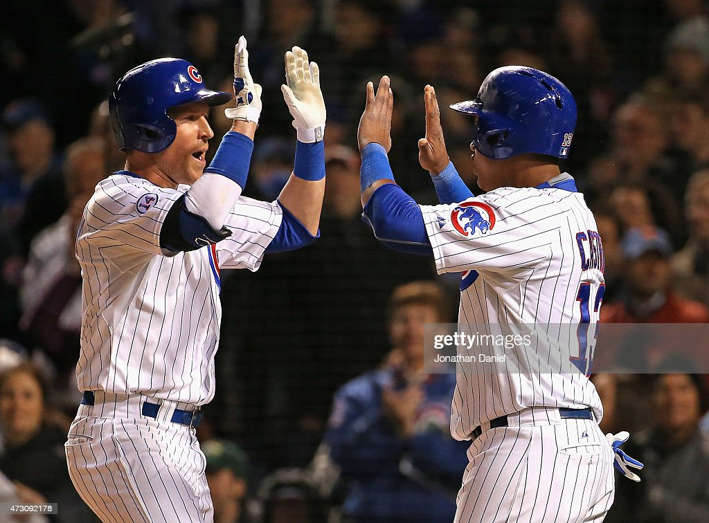 Chris Coghlan #8 of the Chicago Cubs celebrates his two-run home run in the 6th inning against the New York Mets with teammate Starlin Castro #13 at Wrigley Field on May 12, 2015 in Chicago, Illinois.