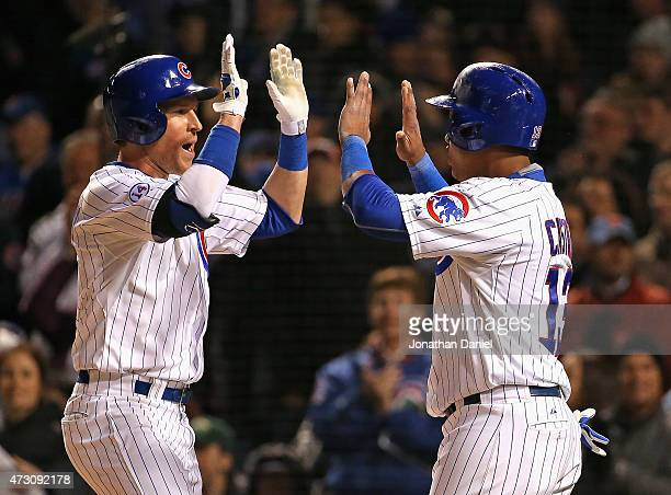 Chris Coghlan of the Chicago Cubs celebrates his two-run home run in the 6th inning against the New York Mets with teammate Starlin Castro at Wrigley...