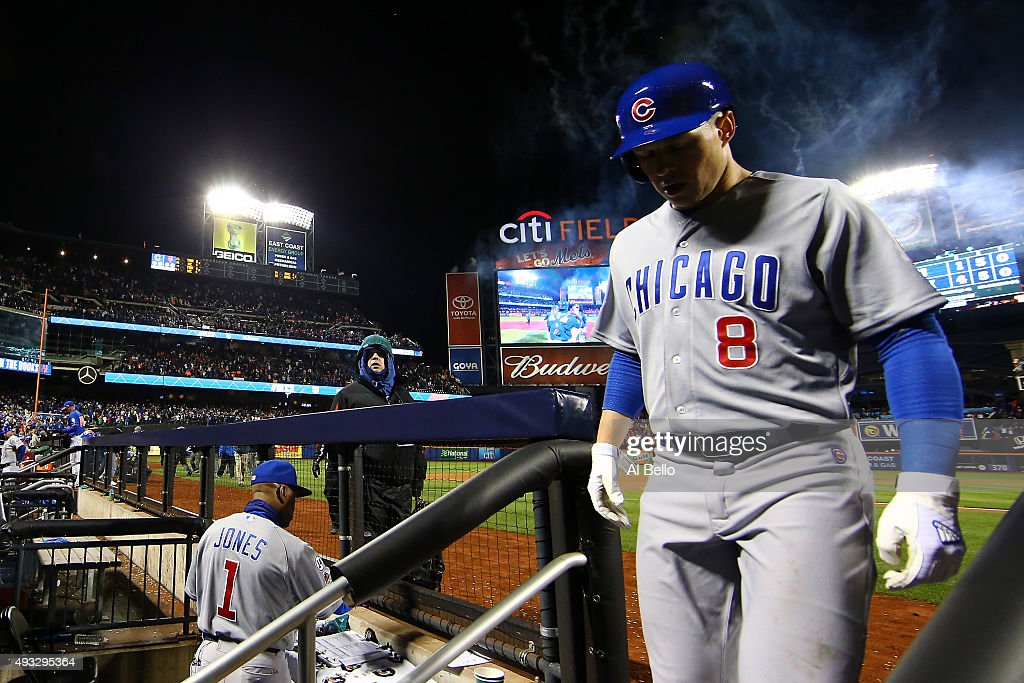 Chris Coghlan #8 of the Chicago Cubs enters the dugout after being tagged out in the ninth inning after game two of the 2015 MLB National League Championship Series at Citi Field on October 18, 2015 in the Flushing neighborhood of the Queens borough of New York City. The Mets defeated the Cubs with a score of 4 to 1.