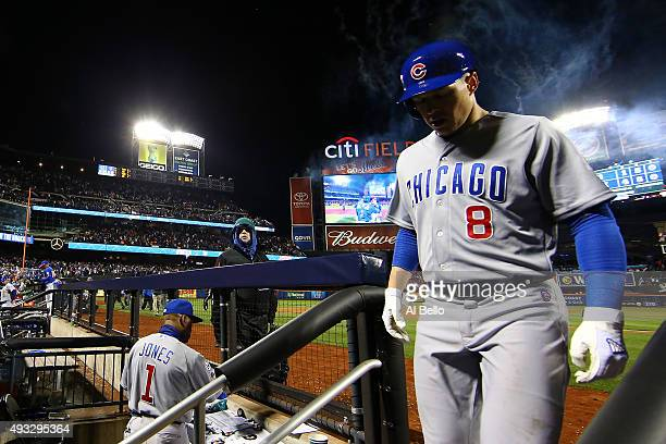 Chris Coghlan of the Chicago Cubs enters the dugout after being tagged out in the ninth inning after game two of the 2015 MLB National League...