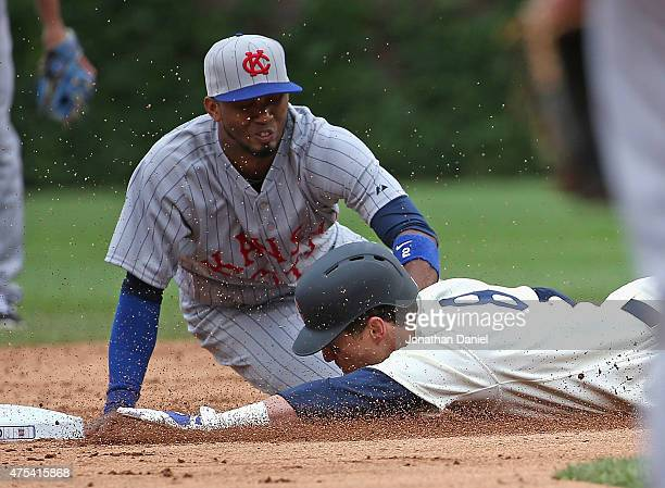 Chris Coghlan of the Chicago Cubs is tagged out at second base by Alcides Escobar of the Kansas City Royals in the 8th inning at Wrigley Field on May...