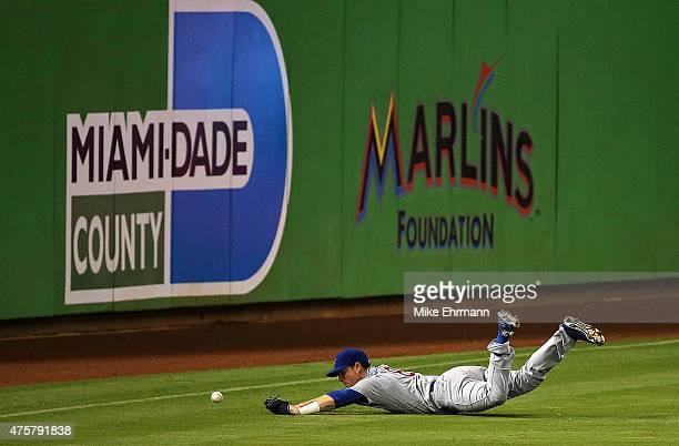 Chris Coghlan of the Chicago Cubs misses a fly ball during a game against the Miami Marlins at Marlins Park on June 3 2015 in Miami Florida
