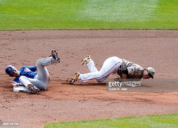 Chris Coghlan of the Chicago Cubs slides into Jung Ho Kang of the Pittsburgh Pirates resulting in injury in the first inning during the game at PNC...