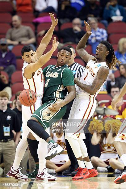 Chris Cokley of the UAB Blazers fights for the ball agaist Naz Long and Jameel McKay of the Iowa State Cyclones during the second round of the 2015...