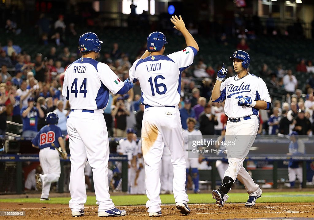 Chris Colabello #25 (R) of Italy is congratulated by Anthony Rizzo #44 and Alex Liddi #16 after Colabello hit a three-run home run against Canada during the third inning of the World Baseball Classic First Round Group D game at Chase Field on March 8, 2013 in Phoenix, Arizona.