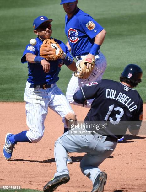 Chris Colabello of the Cleveland Indians is out at second base in the fifth inning against Munenori Kawasaki of the Chicago Cubs during a spring...