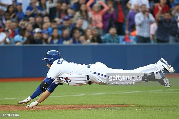 Chris Colabello of the Toronto Blue Jays advances to third base on a throwing error after hitting a double in the third inning during MLB game action...