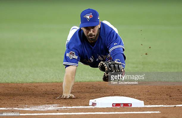 Chris Colabello of the Toronto Blue Jays dives for first base to make an out in the second inning against the Texas Rangers during game two of the...