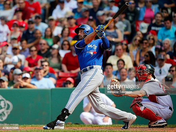 Chris Colabello of the Toronto Blue Jays follows through on a hit during the ninth inning of the Toronto Blue Jays 135 win over the Boston Red Sox in...