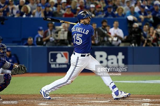 Chris Colabello of the Toronto Blue Jays hits a double in the second inning against the Texas Rangers during game two of the American League Division...