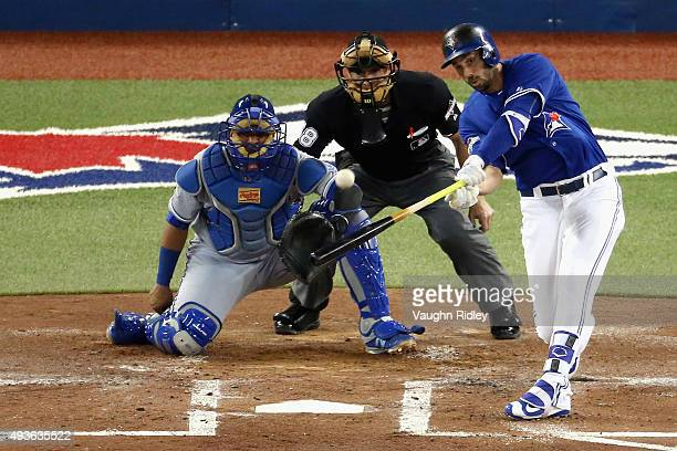 Chris Colabello of the Toronto Blue Jays hits a solo home run in the second inning against the Kansas City Royals during game five of the American...
