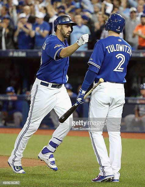 Chris Colabello of the Toronto Blue Jays is congratulated by Troy Tulowitzki of the Toronto Blue Jays after hitting a solo home run in the second...