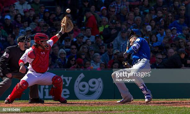 Chris Colabello of the Toronto Blue Jays is hit in the head by a pitch thrown by Steven Wright of the Boston Red Sox during the fourth inning as...