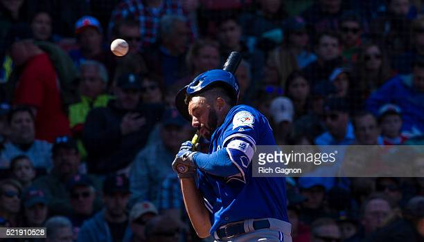 Chris Colabello of the Toronto Blue Jays is hit in the head by a pitch thrown by Steven Wright of the Boston Red Sox during the fourth inning at...