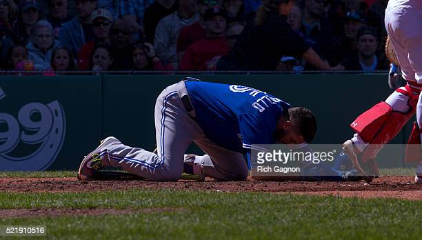 Chris Colabello of the Toronto Blue Jays is on the ground after being hit in the head by a pitch thrown by Steven Wright of the Boston Red Sox during...
