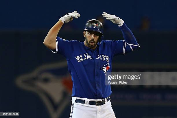 Chris Colabello of the Toronto Blue Jays reacts after a double in the bottom of the second inning against the Texas Rangers during game two of the...