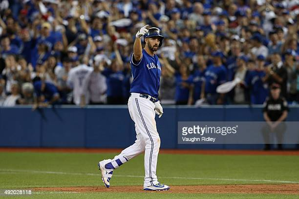 Chris Colabello of the Toronto Blue Jays reacts after a single in the 12th inning against the Texas Rangers during game two of the American League...