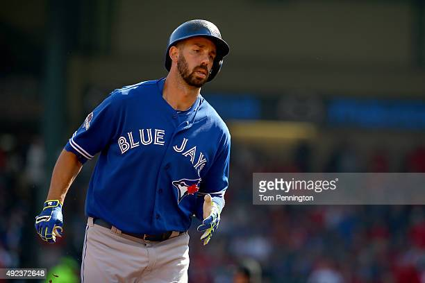 Chris Colabello of the Toronto Blue Jays rounds the bases after hitting a solo home run in the first inning against the Texas Rangers in game four of...