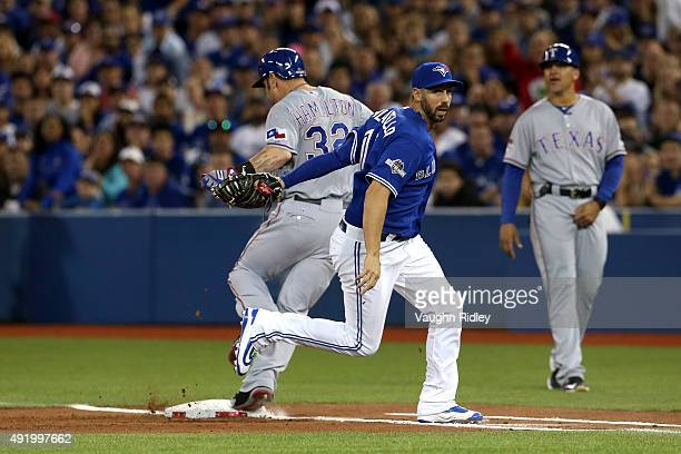 Chris Colabello of the Toronto Blue Jays tags out Josh Hamilton of the Texas Rangers as part of a double play to end the top of the first inning...