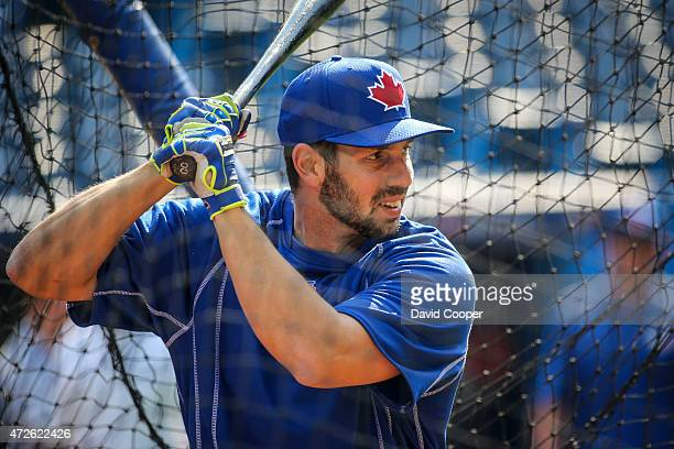 TORONTO ON MAY 8 Chris Colabello of the Toronto Blue Jays takes his turn in the cage during batting practice before the game between the Toronto Blue...