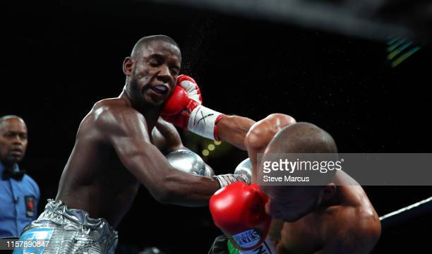 Chris Colbert takes a punch from Albert Mercado during a lightweight fight at the Mandalay Bay Events Center on June 23 2019 in Las Vegas Nevada...