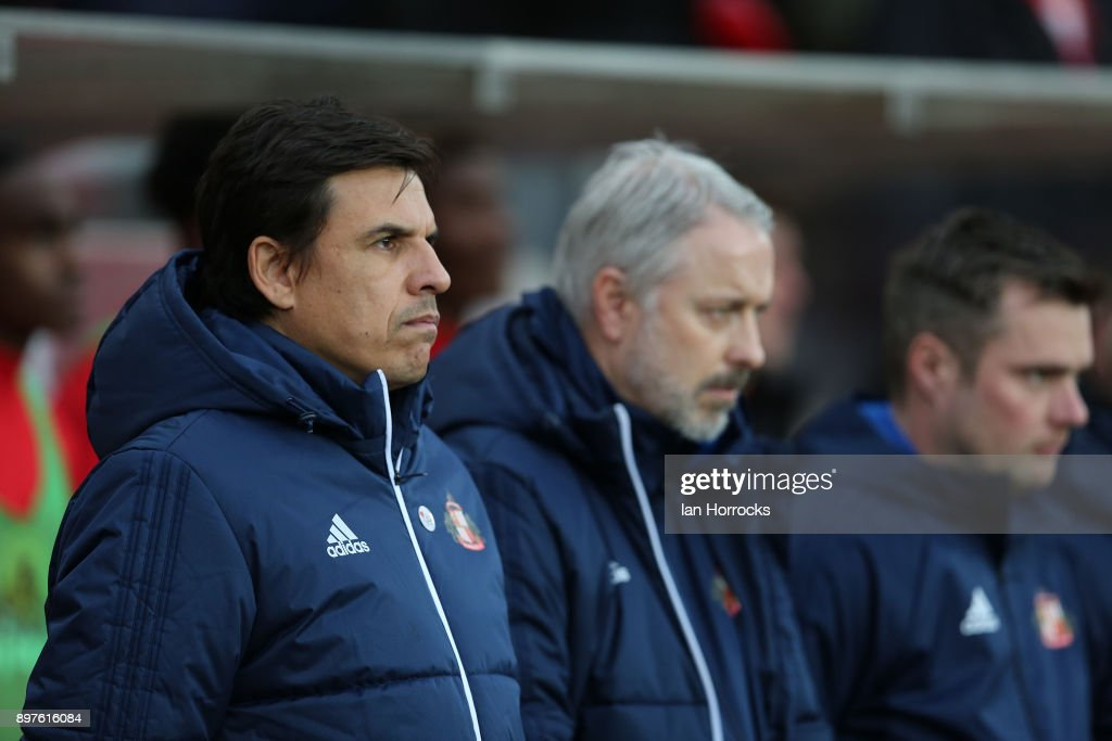 Chris Coleman and his staff observe a minutes silence during the Sky Bet Championship match between Sunderland and Birmingham City at Stadium of Light on December 23, 2017 in Sunderland, England.