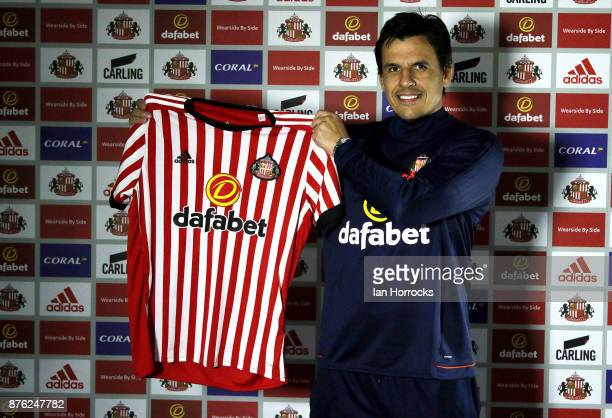 Chris Coleman holds a club shirt after being named as the new Sunderland manager at The Academy of Light on November 19 2017 in Sunderland England