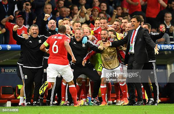 Chris Coleman manager of Wales celebrates Ashley Williams of after scoring his team's first goal during the UEFA EURO 2016 quarter final match...