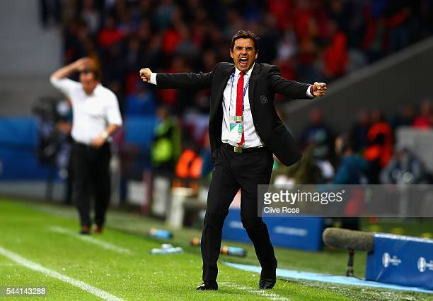 Chris Coleman manager of Wales celebrates his team's first goal during the UEFA EURO 2016 quarter final match between Wales and Belgium at Stade...